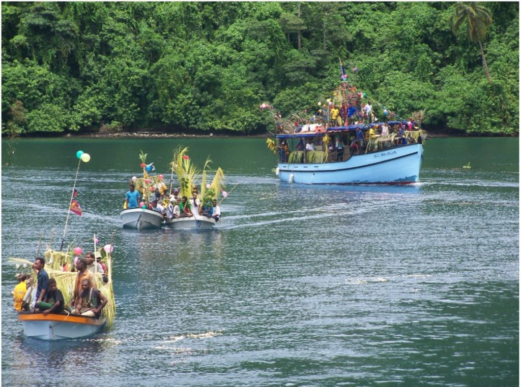 Two decorated smaller banana boats welcoming the new Inter-island motor boat MV West New Britain